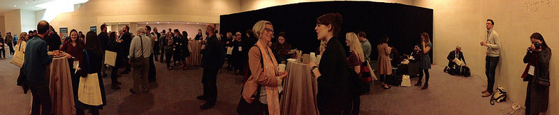 panaoramic scene of conference attendees